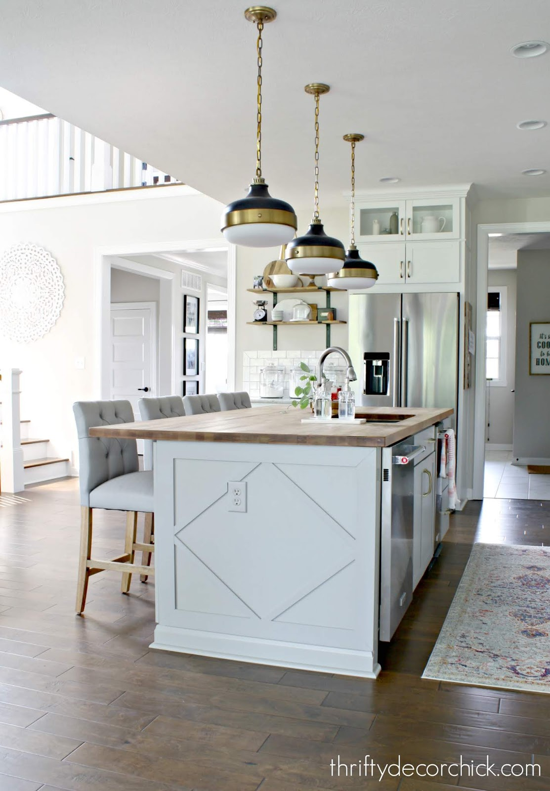 Adding custom detail to a plain kitchen island from Thrifty Decor Chick