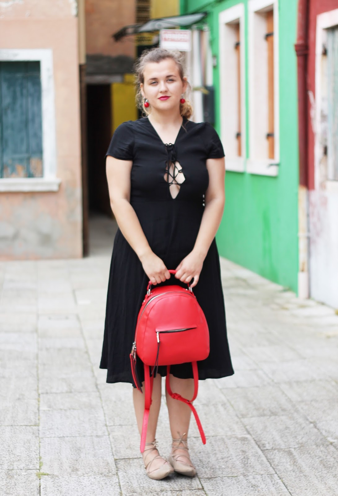 A black midi lace-up dress and lace up flats: perfect for a day on Burano island | fashamorphosis.blogspot.com