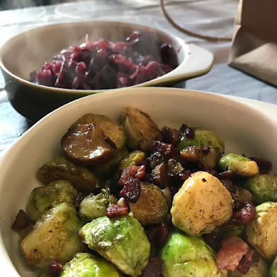 Dishes of red cabbage and sprouts