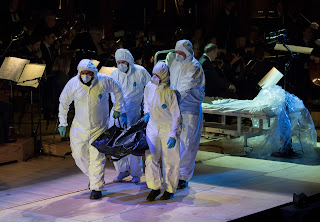 Ligeti - Le grand Macabre - Body of Gepopo (Audrey Luna) being taken off in a body bag by stage crea- John Phillips/Getty Images