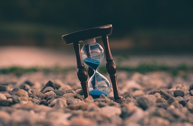 blue hourglass in the pebbles