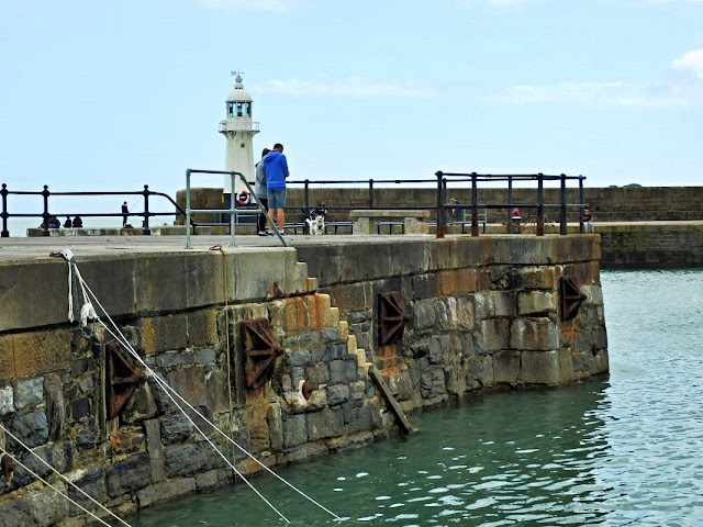 Harbour wall and lighthouse at Mevagissey