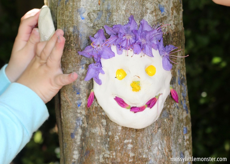 clay faces on trees. outdoor art for kids