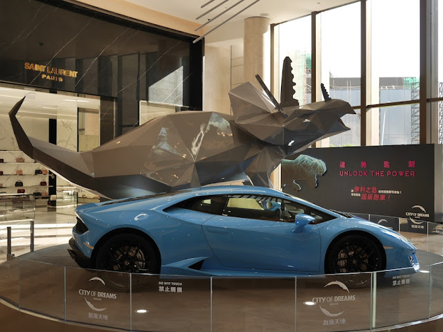 Lamborghini and Triceratops sculpture display at City of Dreams Macau
