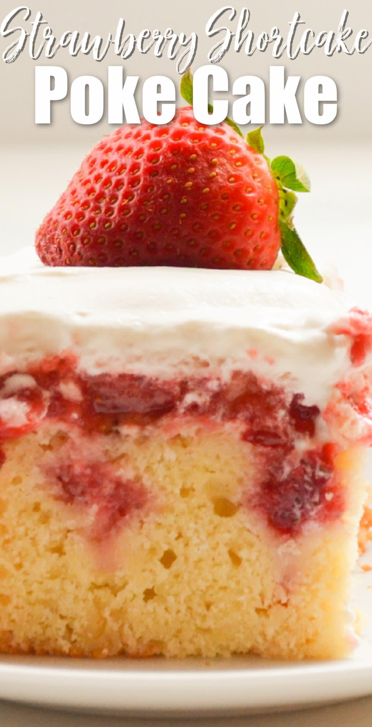 A slice of Strawberry Shortcake Poke Cake with white text at top Strawberry Shortcake Poke Cake.