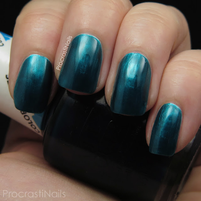Swatch of OPI Turquoise Aesthetic which is a jewel-tone jelly polish