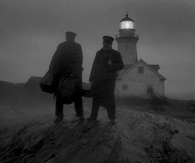 "Willem Dafoe and Robert Pattinson stand on a secluded island in a rainstorm in ""The Lighthouse"" (2019)"