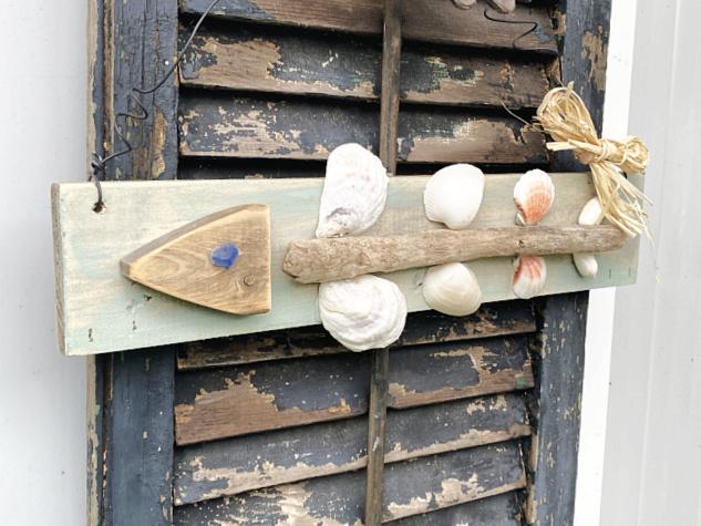 fish art hanging on old shutter