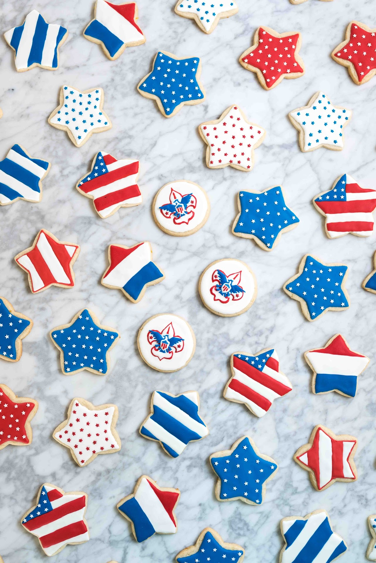 patriotic cookies, dessert, stars, cutout cookies, sugar cookies, lemon sugar cookies, best tasting sugar cookies, royal icing, tips, ideas, how to decorating sugar cookies, best royal icing, boy scout cookies, court of honor, american flag, flag cookies, 4th of july,