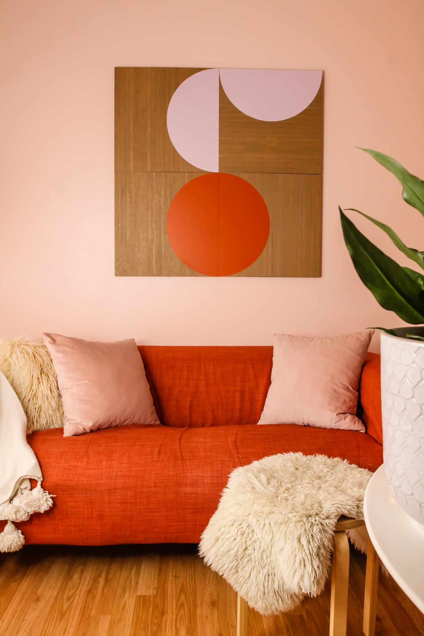 pink and orange decor // spacekit // spacekit decor // sustainable wall art // sustainable home decor // pink and orange room // colorful homes // pink walls // unique wall art // eco friendly wall art // modular wall art // pink room // orange room // orange couch // pink walls // NYC homes // home decor Inspo // office decor inspo // living room inspo // colorful home inspo // space kit modular wall decor // spacekit half moon design // / wall decor inspo // small space living // small spaces inspo // pink room inspo // pink office decor inspo // colorful rooms // sustainable wall decor // sustainable home decor