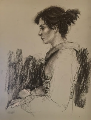 charcoal drawing of woman in profile