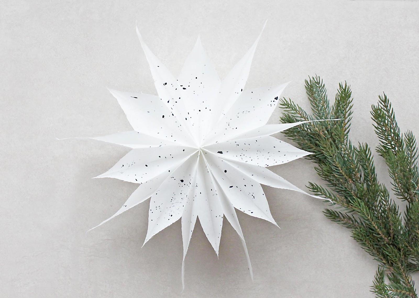 einfache DIY Weihnachssterne aus Butterbrottüten basteln