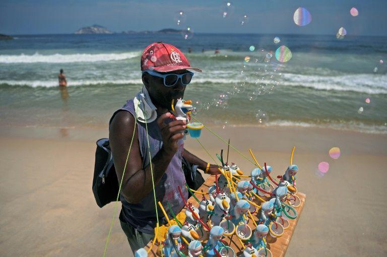 Пляжный продавец товаров, Ипанема, Бразилия