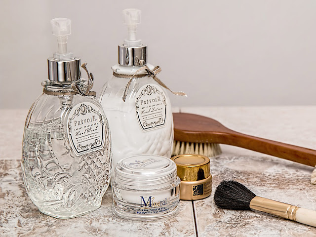 Vintage spray bottles of soap and lotion and other cosmetics