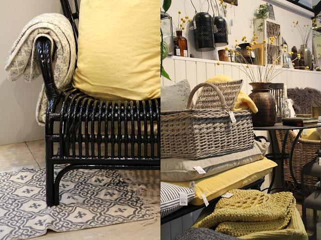 schwarzer Rattan Sessel von Ib Laursen und gelbe Accessoires von Ib Laursen auf der Ambiente 2016