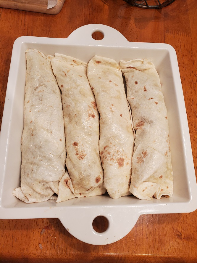 these are flour tortilla filled with rice, beans and cheeses