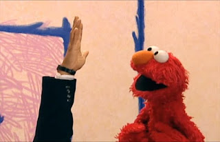 The hand and Elmo count five fingers. Sesame Street Elmo's World Hands Interview