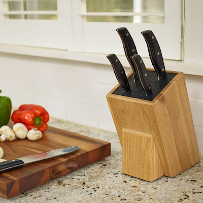 wooden knife block filled with black plastic rods