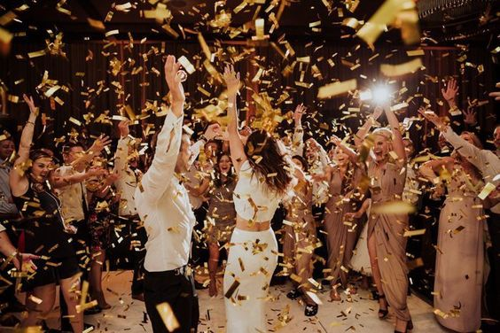 wedding ideas - wedding planning services in Philadelphia PA - reception dancing - bride and groom dancing with confetti thrown by guests - wedding ideas blog by K'Mich