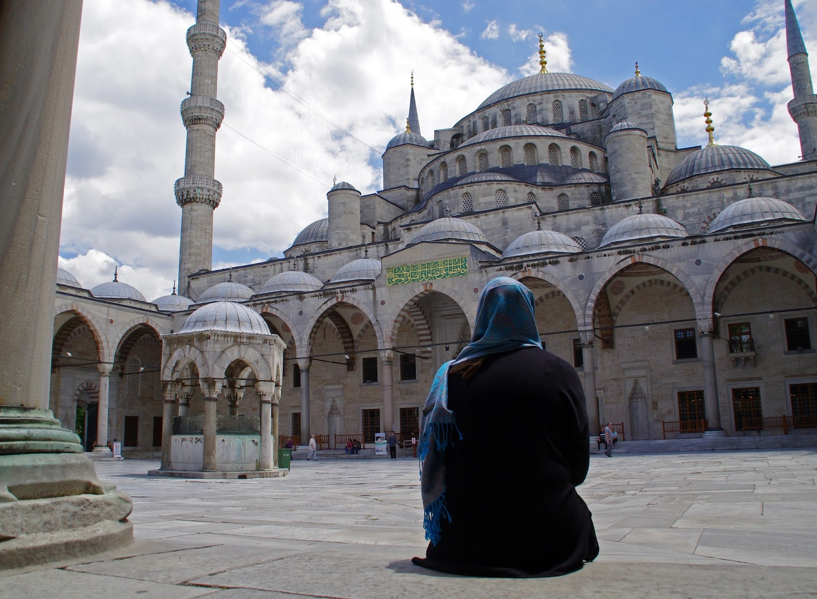Girl in courtyard of Blue Mosque Istanbul
