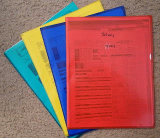 Plastic folders with player character sheets