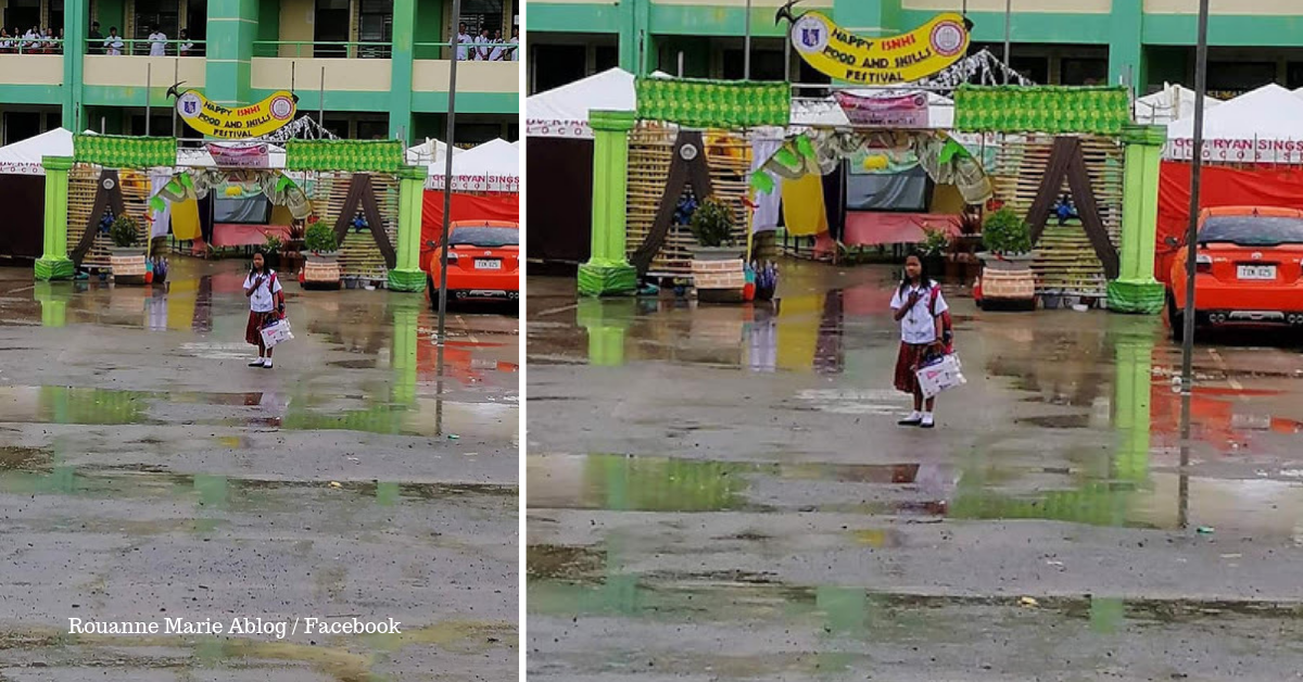 Student Goes Viral for Stopping, Paying Respect to the Flag Even Under the Rain