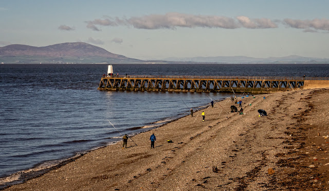 Photo of fishermen taking part in an angling competition on the shore at Maryport
