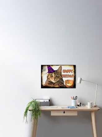 Halloween Cat poster on wall above desk