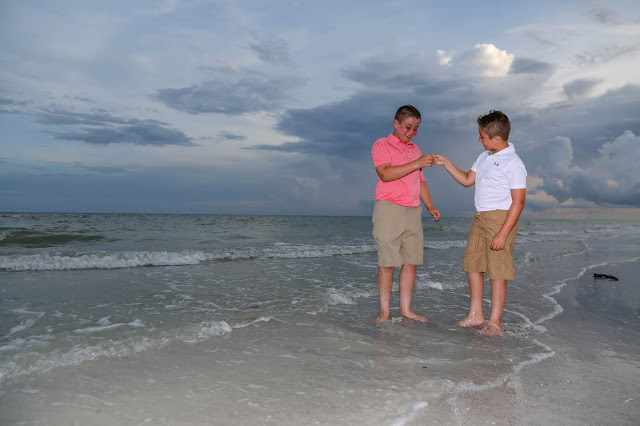 sanibel island family beach pictures in coral in blue