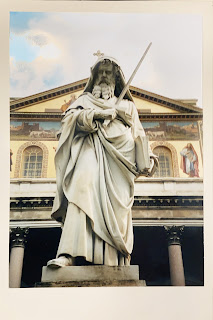 Sculpture of Paul of Tarsus holding a sword in front of the Church of Saint Paul Outside the Walls in Rome, Italy