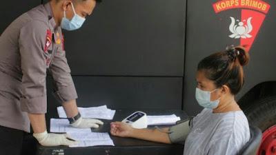 Brimob Polda Sulut Terus Berupaya Lakukan Vaksinasi Massal