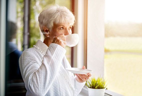Older Woman Drinking Coffee