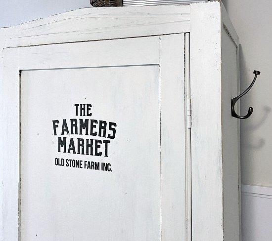 Farmhouse transfer on a craft cabinet
