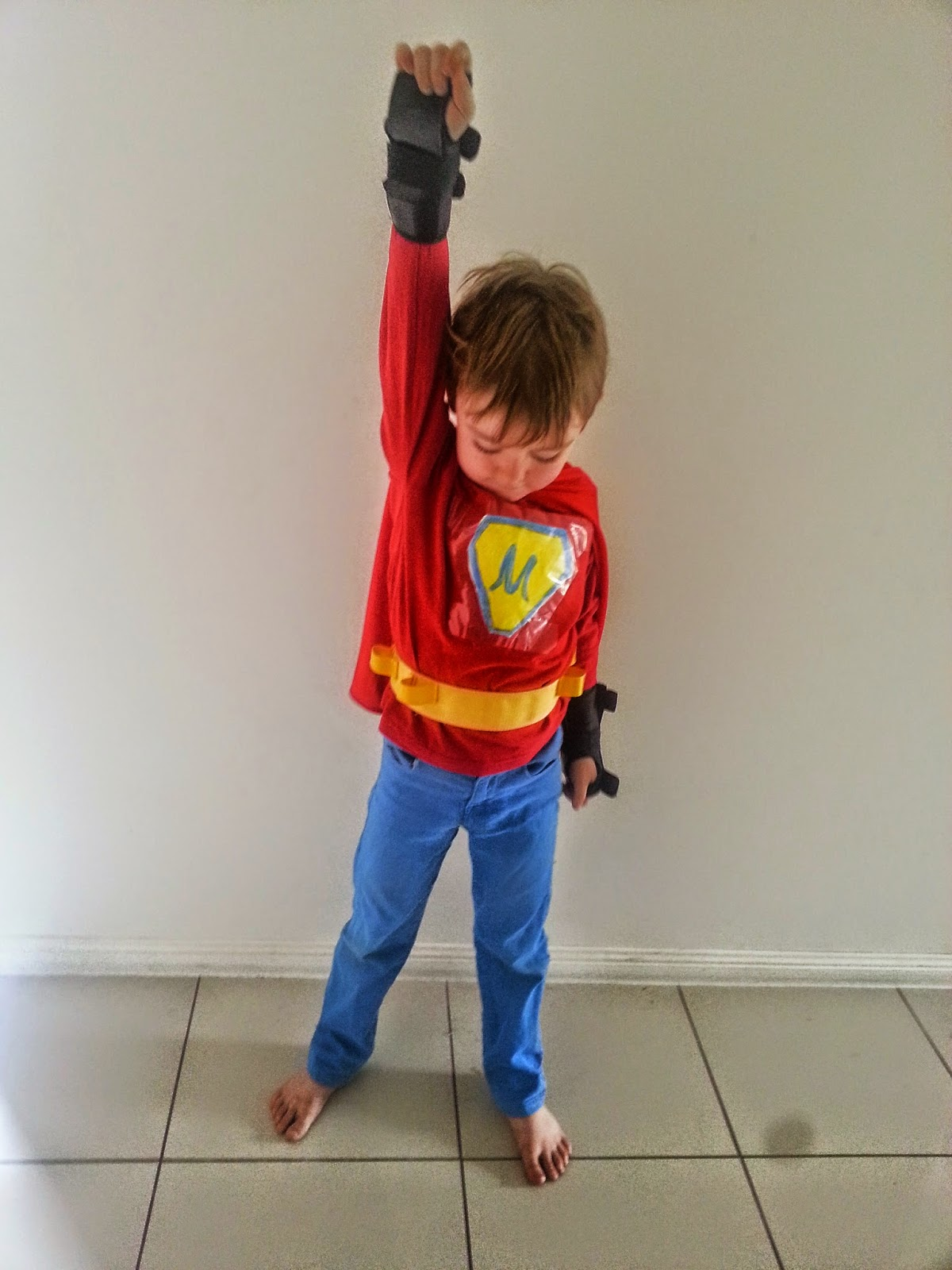 Photo of young boy in homemade superhero outfit