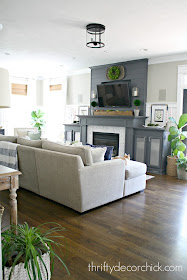 Sectional and dark gray fireplace