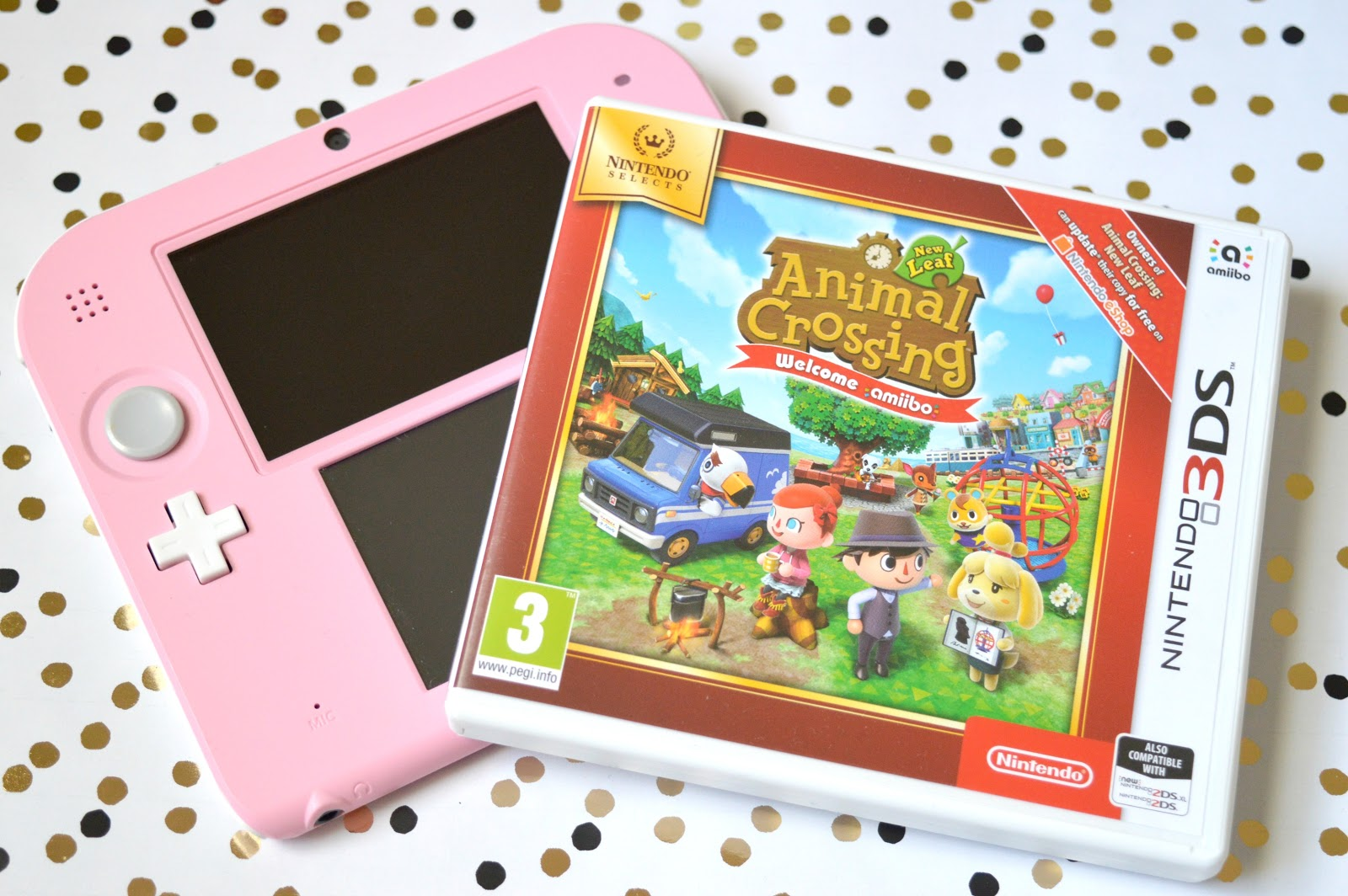 Animal Crossing New Leaf for Nintendo 3DS with a pretty pink Nintendo 2DS console
