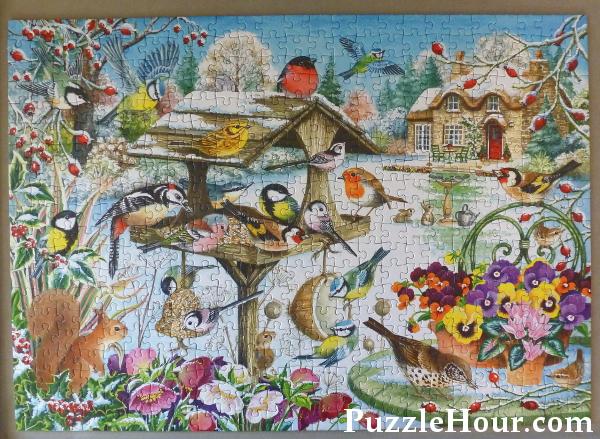 Falcon de luxe Winter Garden Birds Jigsaw Puzzle Completed Robin Goldfinch Woodpecker Bird Table Violas