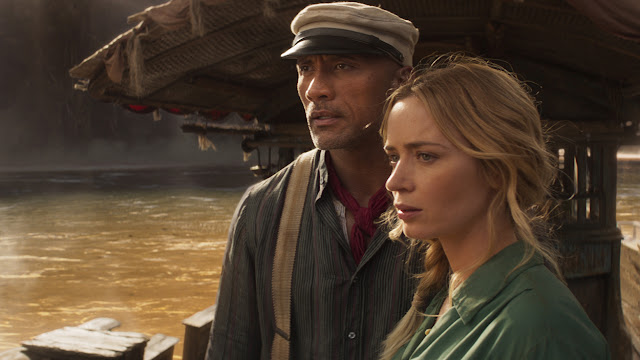 dwayne johnson and emily blunt on a boat