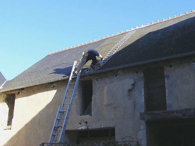 Descending a roof, Indre et Loire, France. Photo by Loire Valley Time Travel.