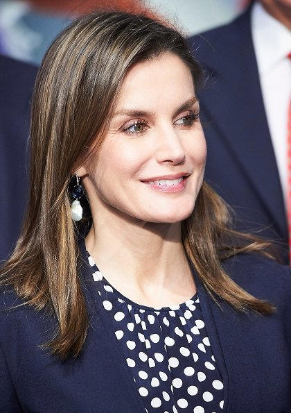 Queen Letizia wore Carolina Herrera blouse and Hugo Boss suit