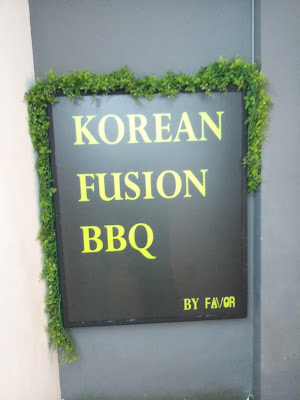 A portrait picture of the name of the restaurant, 'Korean Fusion BBQ'