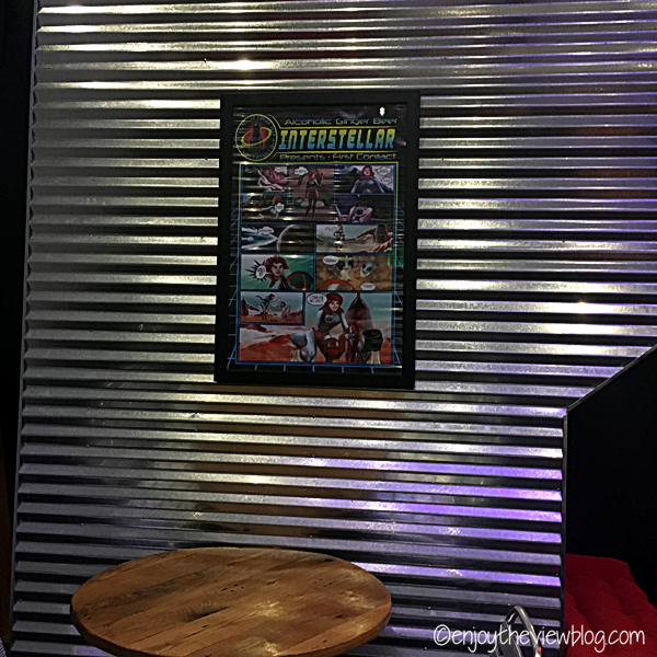corrugated aluminum wall with an alien comic poster