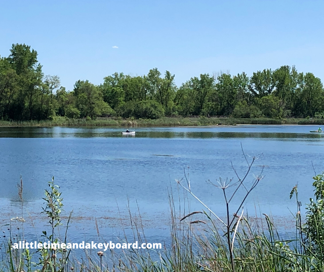 Boating on a summer day on tranquil Mallard Lake in Hanover Park, Illinois