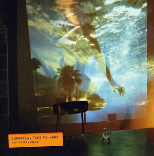 Album cover - picture of someone swimming in  a pool being projected onto a room wall