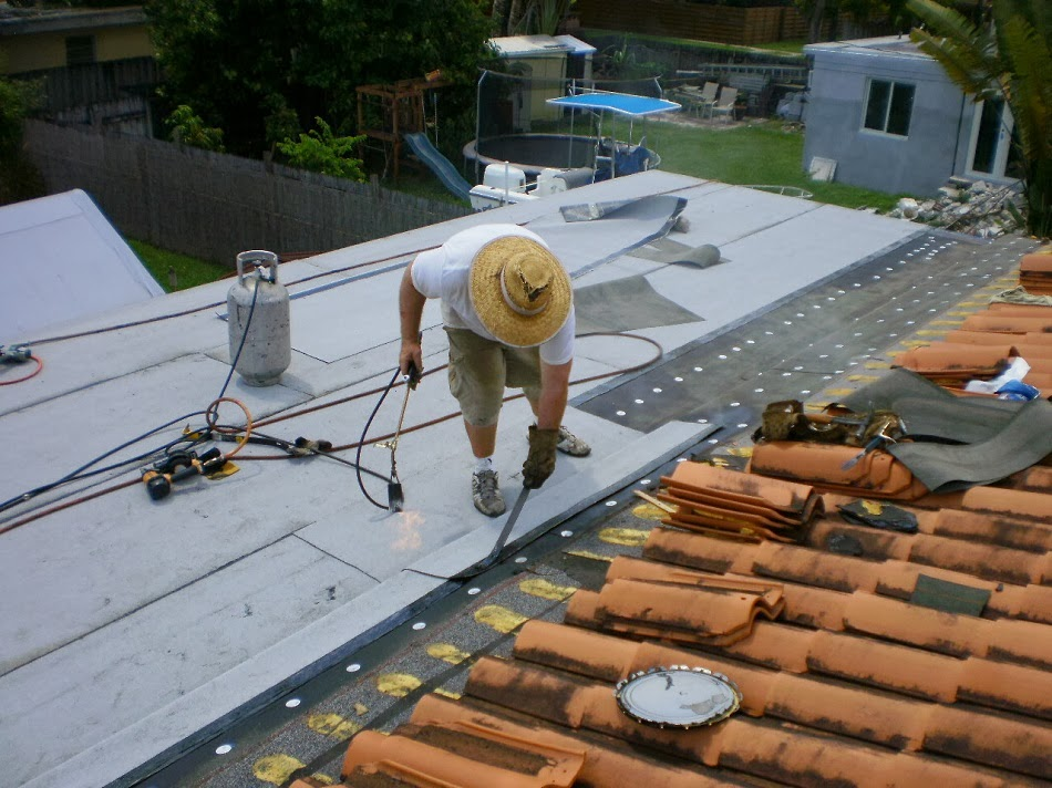 Roofer Mike on Flat Roof in Miami Springs