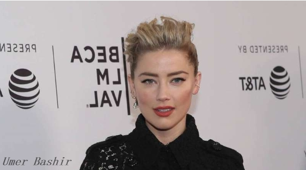 Amber Heard alleges sexual harassment of a former aide 'stealing and twisting'