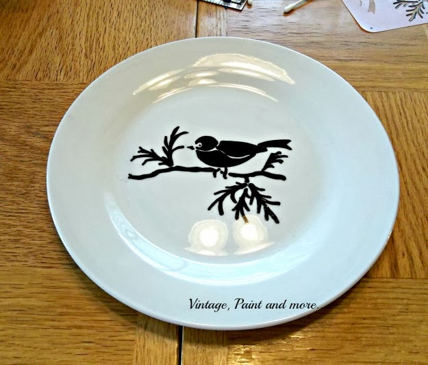 the completed bird stencil on the plate