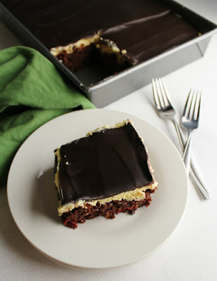 looking down on a slice of black forest sheet cake with remaining cake in background