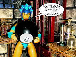 Evil-Lyn says: Outlook not so good and she holds a Magic 8 Ball toy.