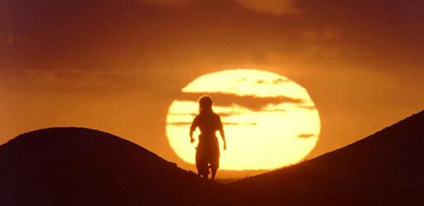 Liu Kang (Ludi Lin) arrives at sunset in MORTAL KOMBAT.